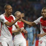 Monaco's Fabinho celebrates with Kylian Mbappe-Lottin.