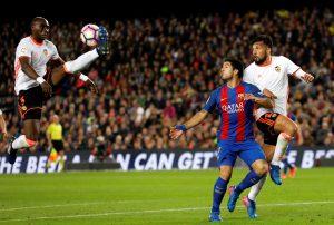 Eliaquim Mangala in action next to Luis Suarez and Ezequiel Garay.