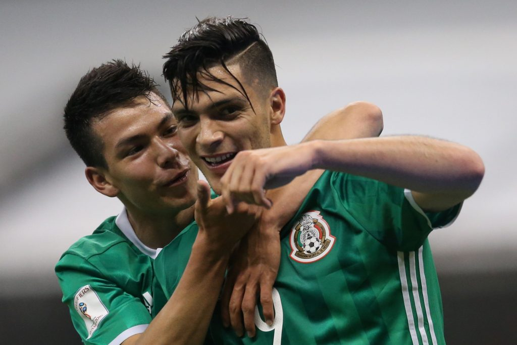 Mexico's Raul Jimenez (R) celebrates a goal against Honduras.
