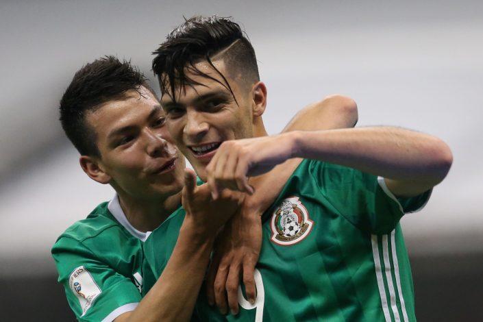 Mexico's Raul Jimenez (R) celebrates a goal against Honduras.