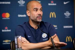Manchester City's Manager Pep Guardiola speaks during a news conference.