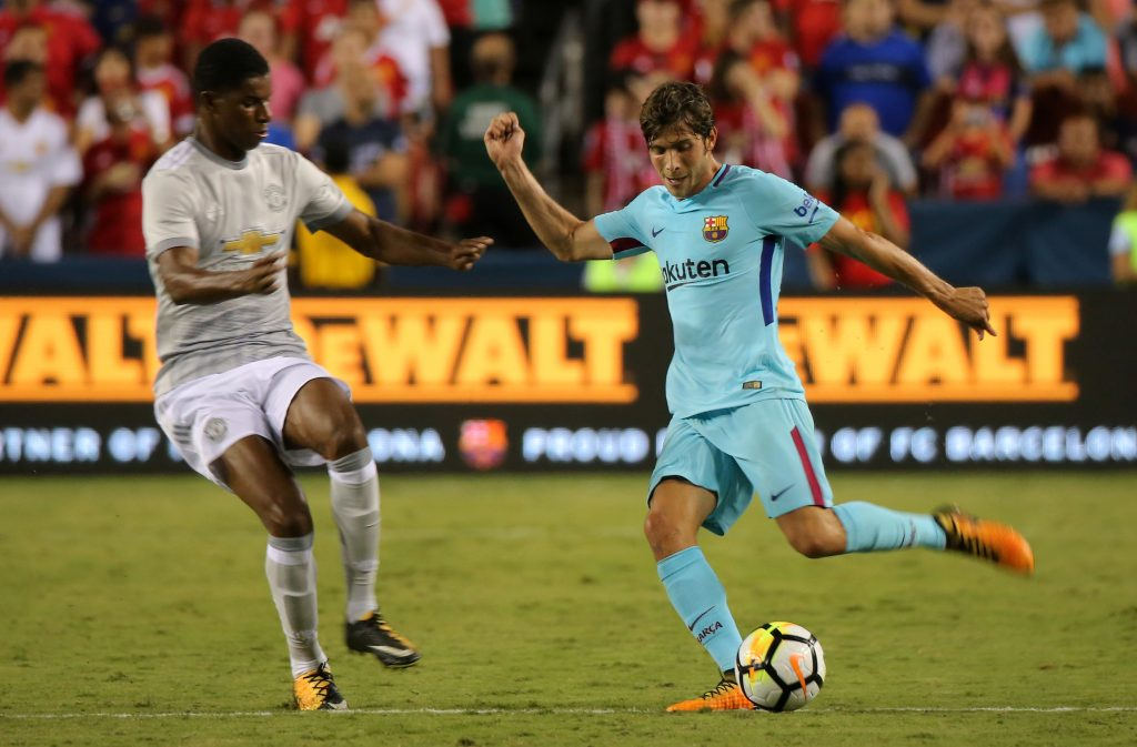 Sergi Roberto in action with Marcus Rashford.