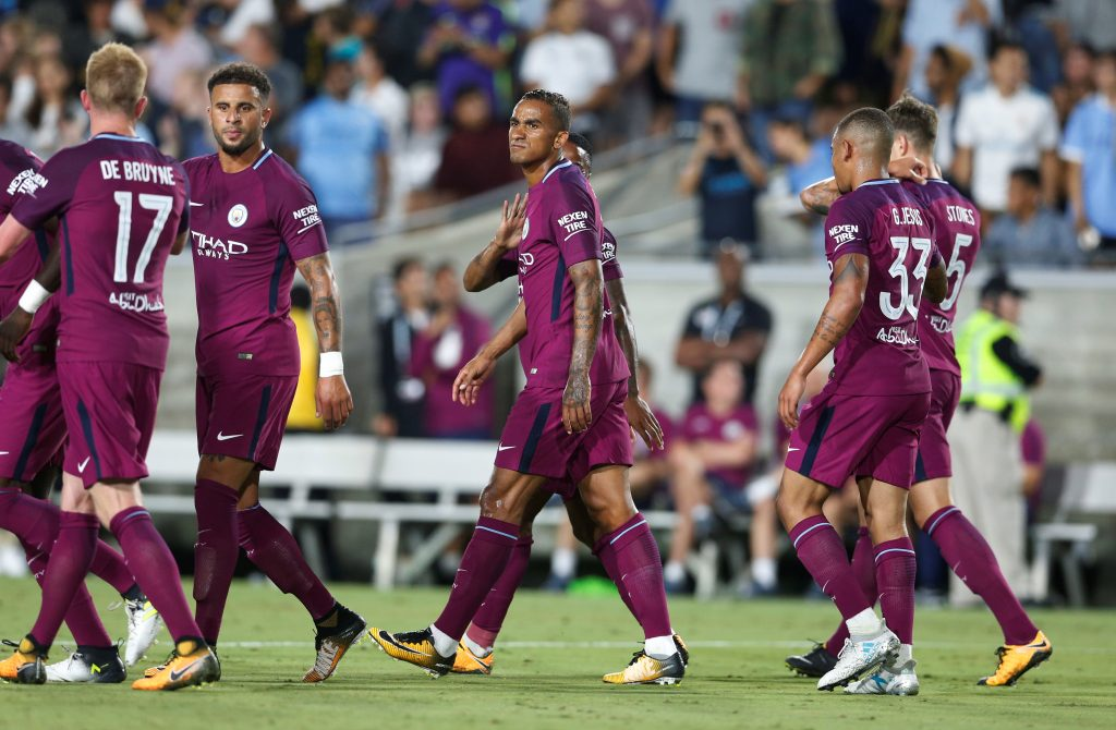 Manchester City's Danilo celebrates a goal with team mates.