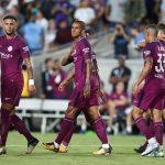 Manchester City's Danilo celebrates a goal with team mates.