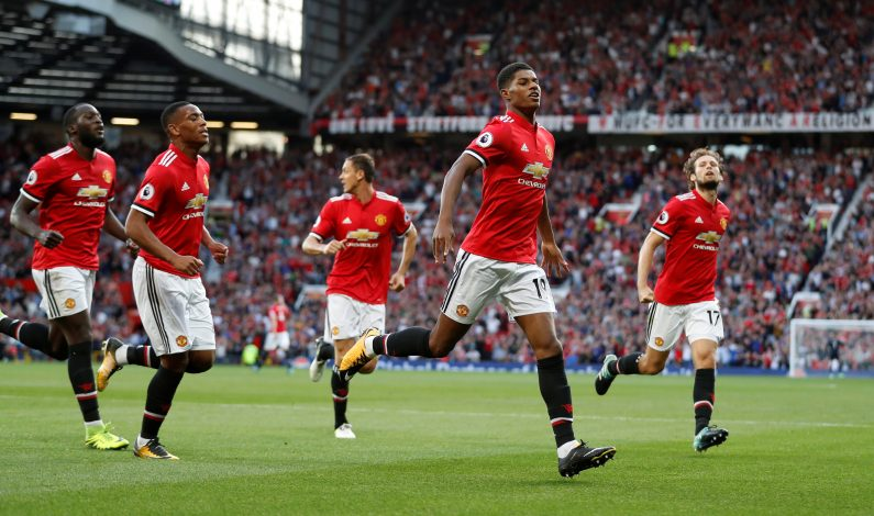 Manchester United's Marcus Rashford celebrates scoring their first goal with teammates.