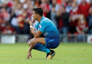 Arsenal's Alexis Sanchez looks dejected.