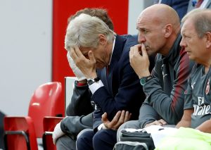 Arsenal manager Arsene Wenger looks dejected.