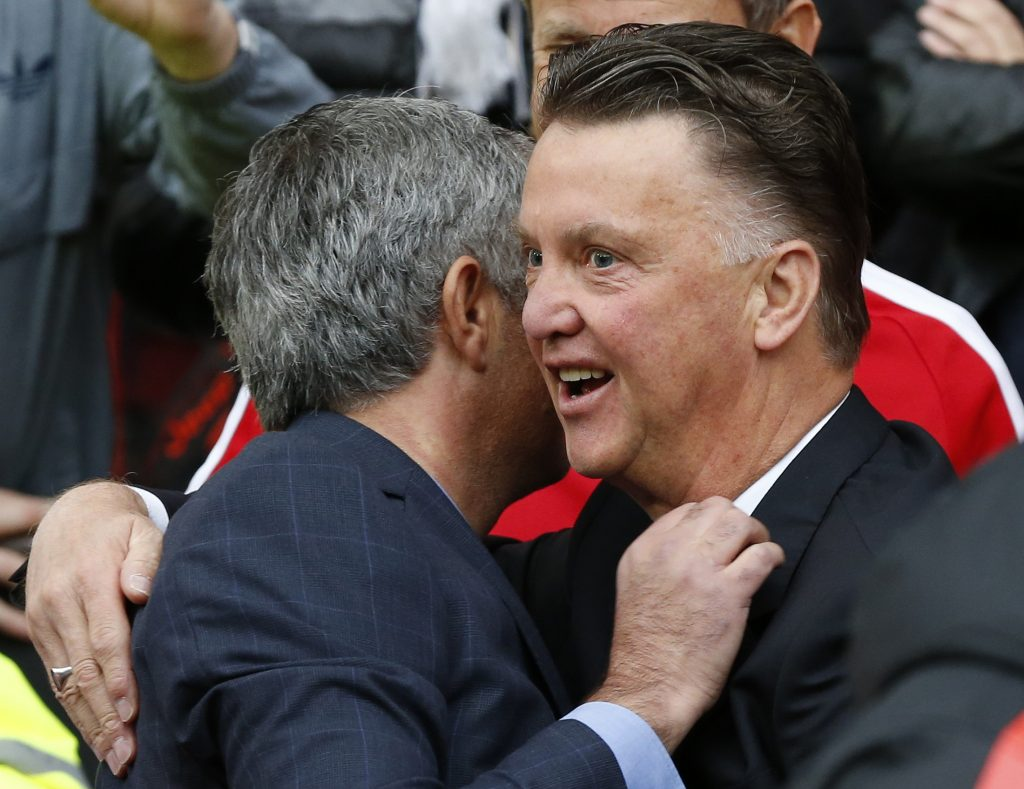 Louis van Gaal (R) greets Jose Mourinho.