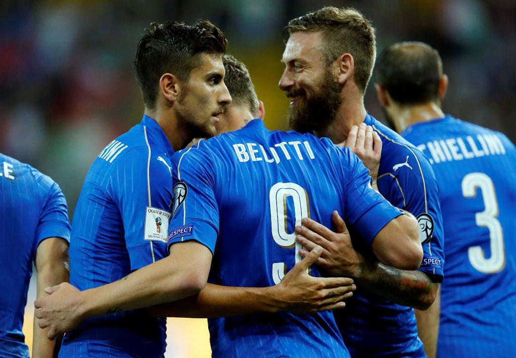 Italy's Andrea Belotti (C) celebrates with team mates Lorenzo Pellegrini (L) and Daniele De Rossi.