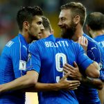 Italy's Andrea Belotti (C) celebrates with team mates Lorenzo Pellegrini (L) and Daniele De Rossi.