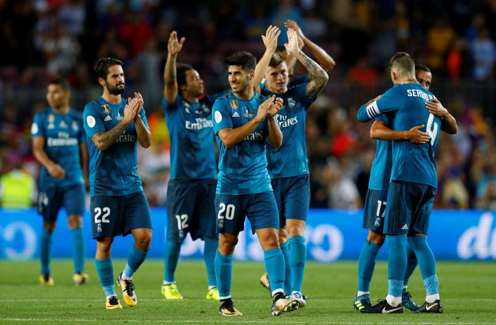 Real Madrid's Marco Asensio celebrates with teammates after the match.