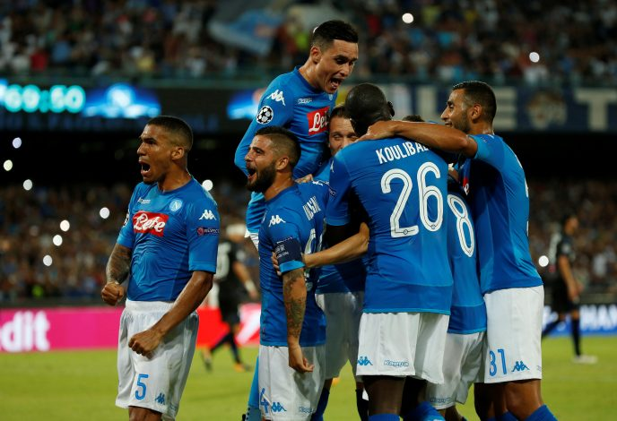 Napoli's Jorginho celebrates scoring their second goal with team mates.