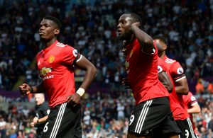 Manchester United's Eric Bailly celebrates scoring their first goal with Romelu Lukaku and Paul Pogba.