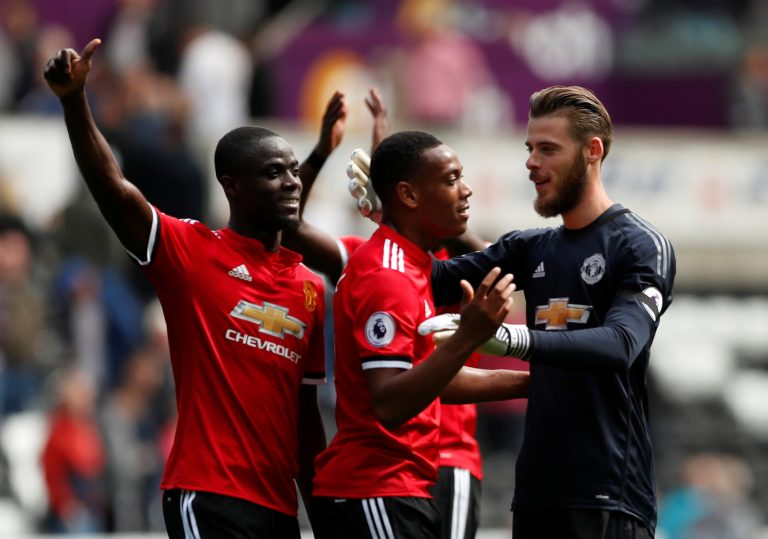 Anthony Martial, Eric Bailly and David De Gea celebrate at the end of the match.