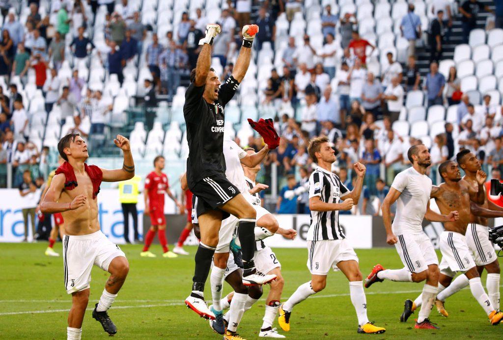Juventus' Gianluigi Buffon and teammates celebrate after the match.