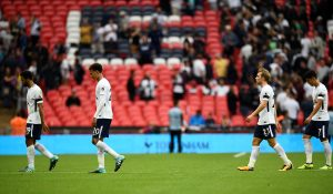 Tottenham's Dele Alli (2nd L) and team mates look dejected after the match.