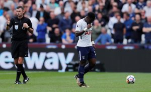 Tottenham's Serge Aurier looks dejected after being sent off.