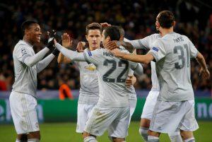 Henrikh Mkhitaryan celebrates scoring their fourth goal with Anthony Martial, Nemanja Matic and team mates.