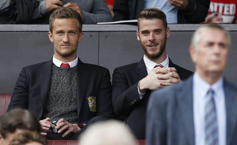Anders Lindegaard and David de Gea watch from the stands.
