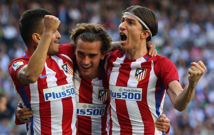 Atletico Madrid's Antoine Griezmann (C) celebrates his goal with his teammates Angel Correa (L) and Filipe Luis.