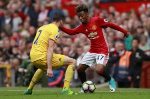 Manchester United's Angel Gomes in action with Crystal Palace's Joel Ward.