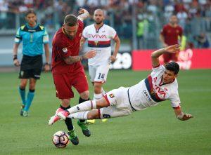 Roma's Daniele De Rossi in action with Genoa's Pietro Pellegri.