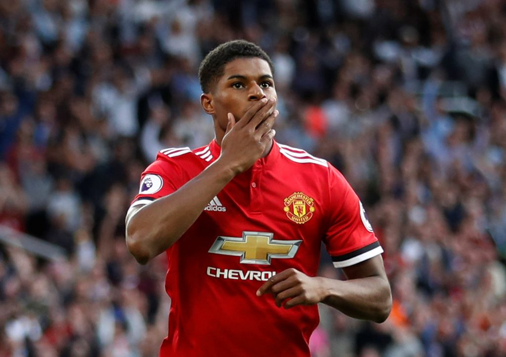 Manchester United's Marcus Rashford celebrates scoring their first goal.