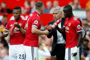 Jose Mourinho speaks with Phil Jones, Eric Bailly and Antonio Valencia.