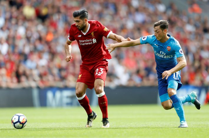 Liverpool's Emre Can in action with Arsenal's Mesut Ozil.