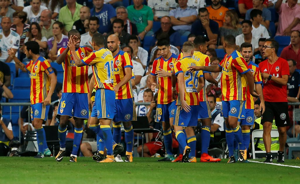 Valencia's Geoffrey Kondogbia celebrates scoring their second goal with teammates.