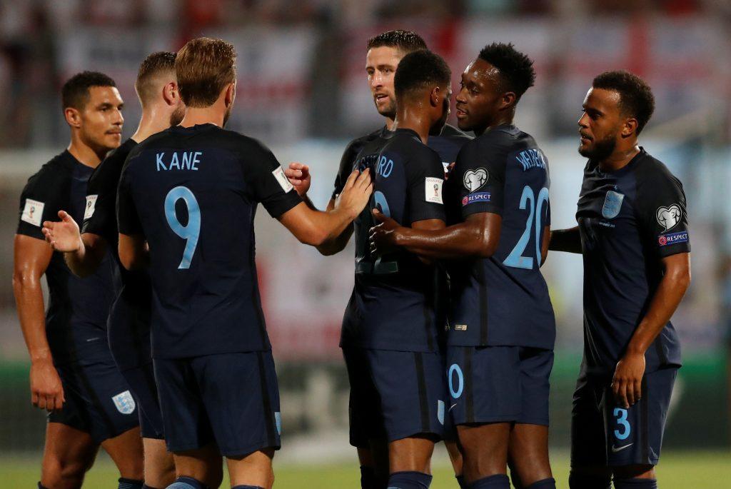 England's Ryan Bertrand (R) celebrates scoring their second goal with team mates.