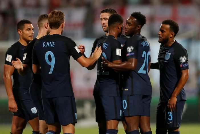 England's Ryan Bertrand (R) celebrates scoring their second goal with team mates.