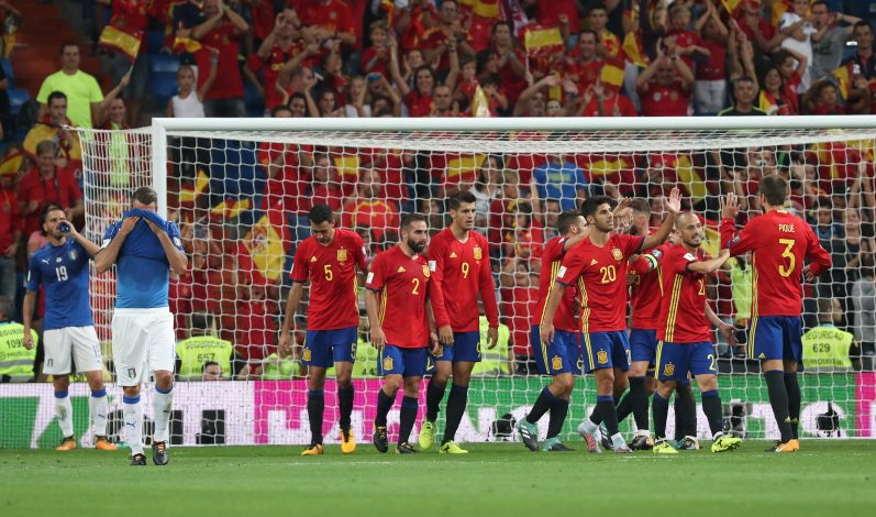 Spain's Alvaro Morata celebrates scoring their third goal with team mates.
