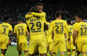 Paris Saint-Germain's Neymar celebrates scoring their third goal with Kylian Mbappe.