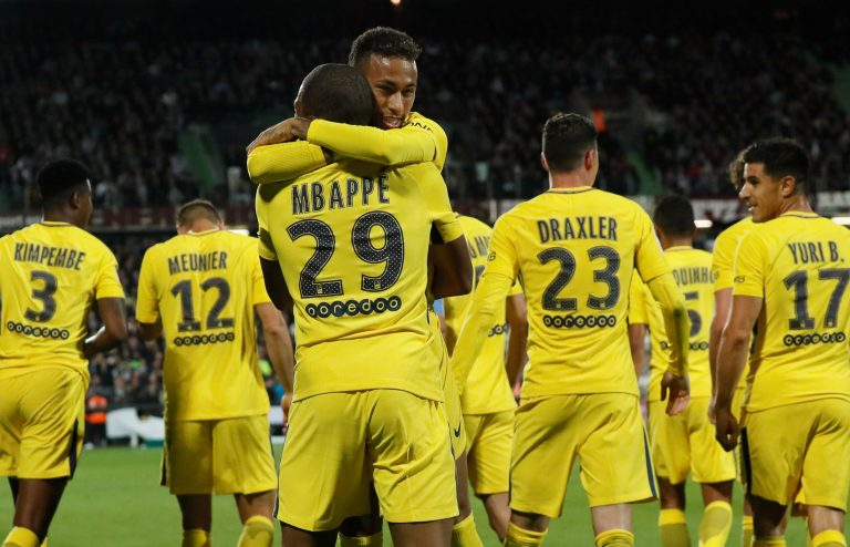Paris Saint-Germain's Neymar celebrates scoring their third goal with Kylian Mbappe.