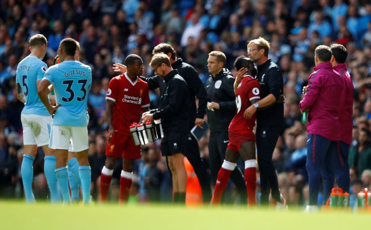 Liverpool's Sadio Mane is hugged by manager Jurgen Klopp as he walks off dejected after being sent off.