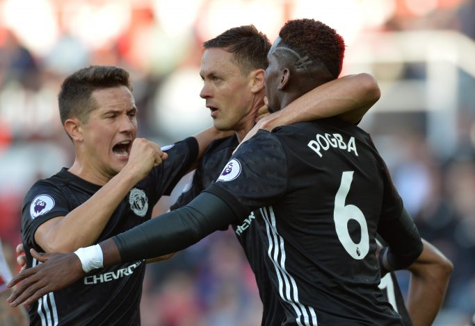 Paul Pogba celebrates with Nemanja Matic and Ander Herrera.