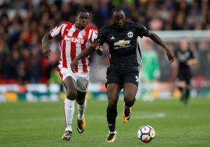 Romelu Lukaku in action with Kurt Zouma.