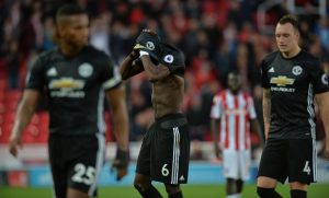 Paul Pogba and Phil Jones look dejected at the end of the match.