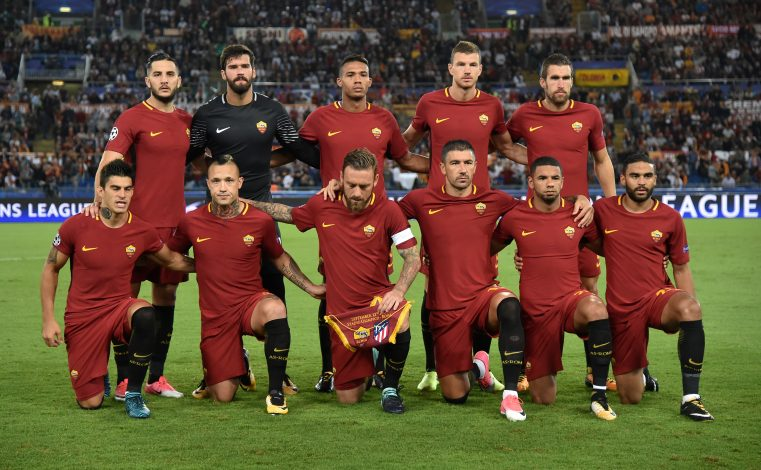 Roma players pose for the pre match photograph.