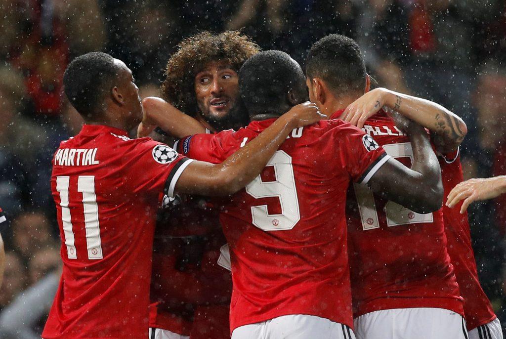 Manchester United's Marouane Fellaini celebrates scoring their first goal with teammates.