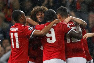 Manchester United's Marouane Fellaini celebrates scoring their first goal with teammates.