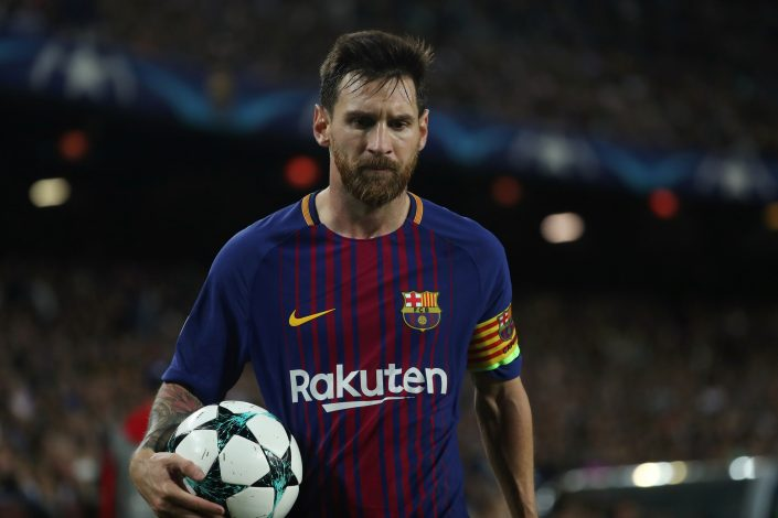 Barcelona's Lionel Messi wears the captain's and a Catalan arm band.