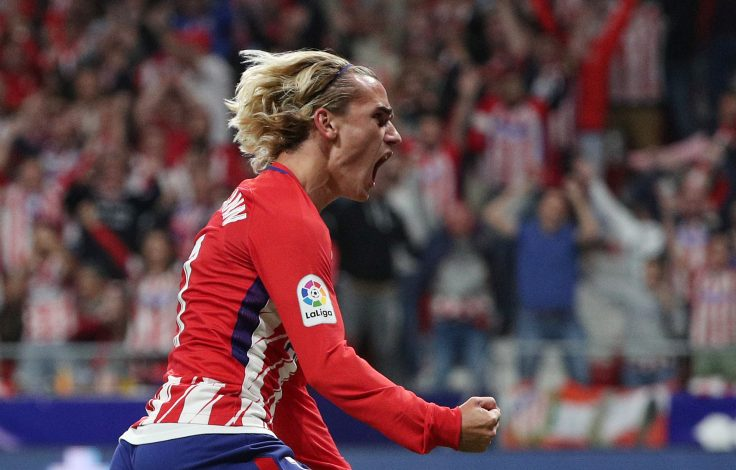 Atletico Madrid's Antoine Griezmann celebrates scoring their first goal.