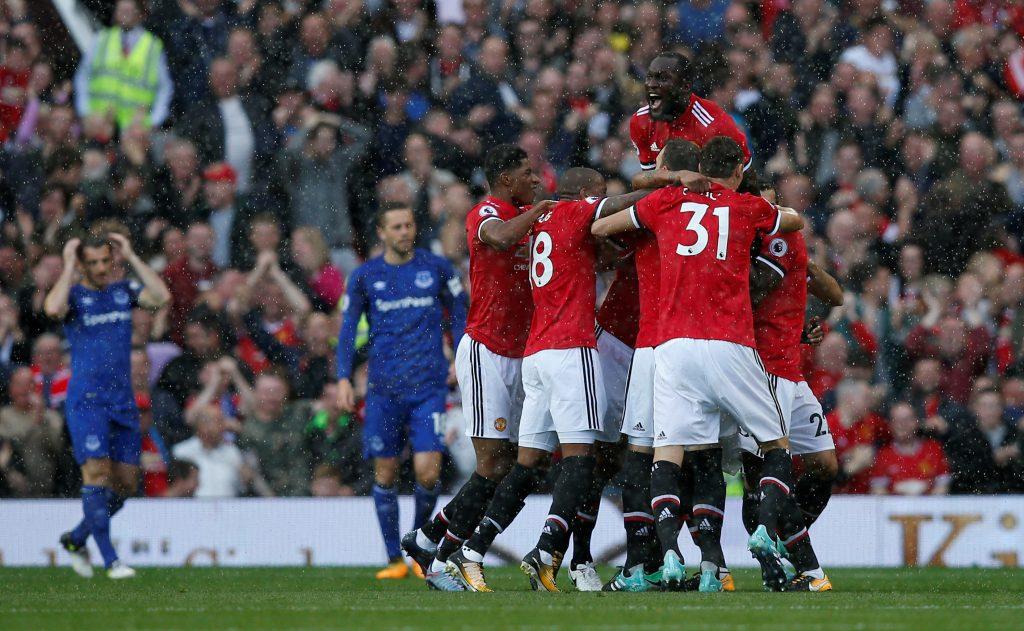 Manchester United's Antonio Valencia celebrates scoring their first goal with team mates.