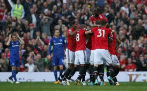 Manchester United's Antonio Valencia celebrates scoring their first goal with team mates.