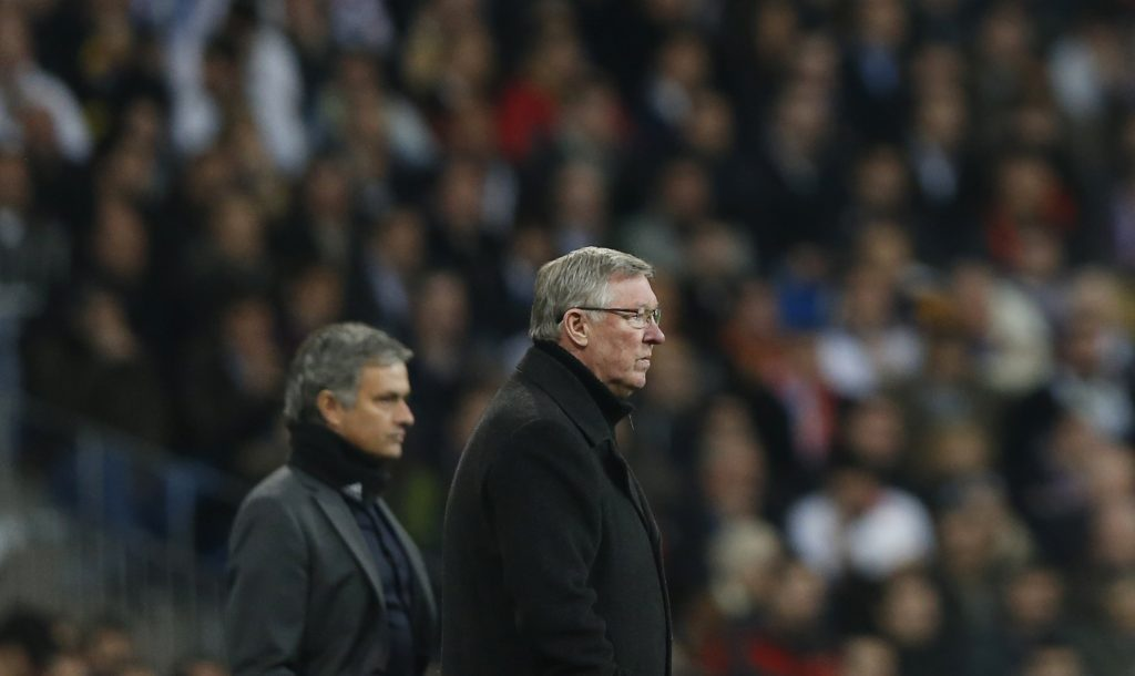 Alex Ferguson (R) and Jose Mourinho watch the Champions League soccer match at Santiago Bernabeu stadium.