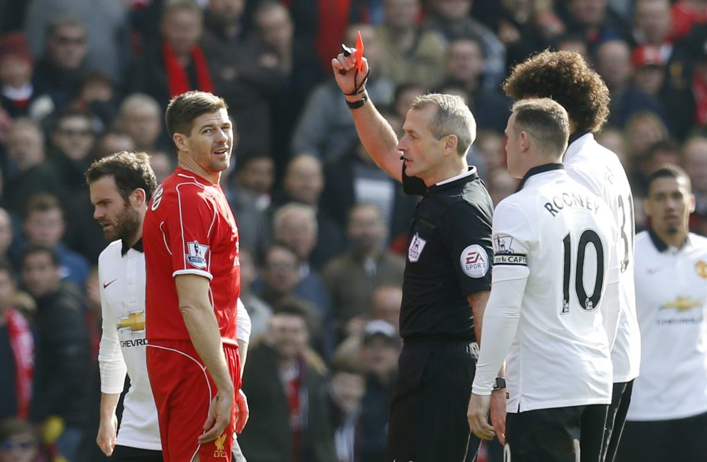 Steven Gerrard is shown a red card by referee Martin Atkinson.