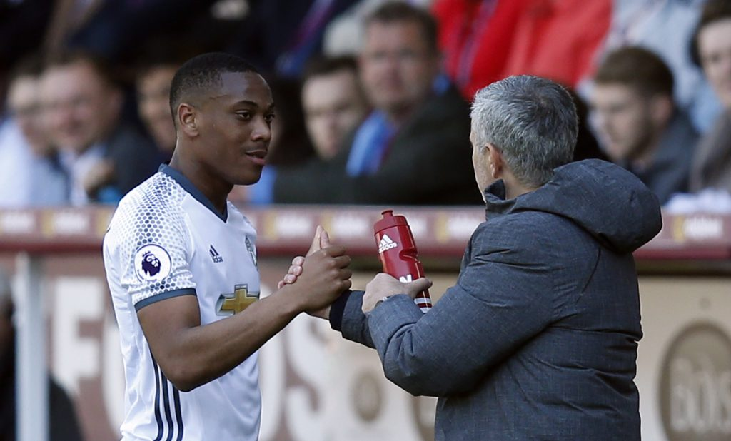 Anthony Martial is congratulated by manager Jose Mourinho after he is substituted.