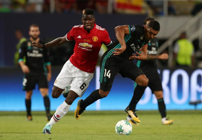 Real Madrid's Casemiro in action with Manchester United's Paul Pogba.